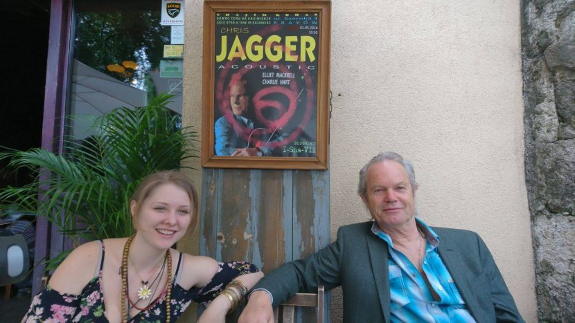 I-Sha-Vii and Chris Jagger sitting next to a poster with their names
